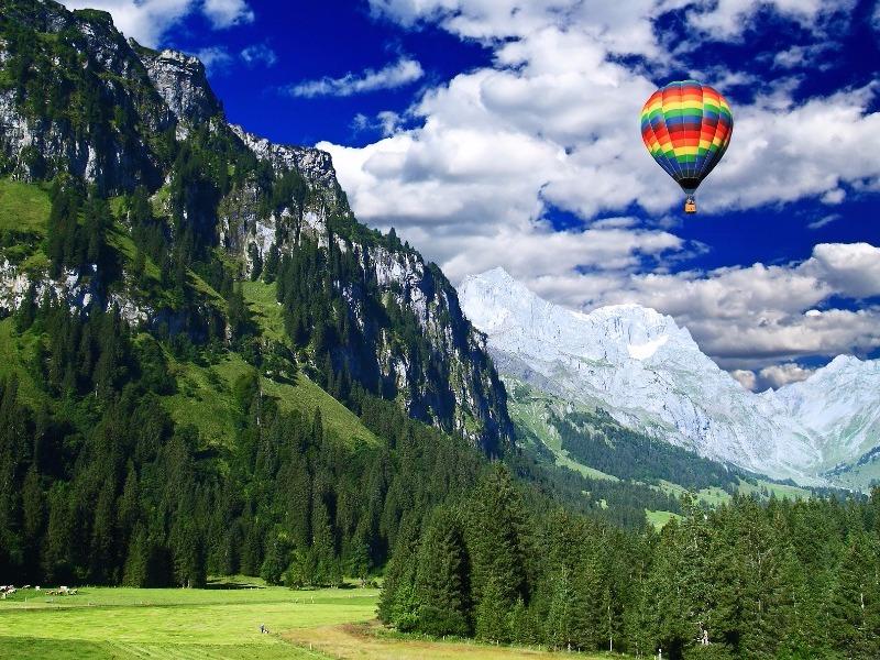 Hot-air balloon over the Swiss Alps near Ghaa