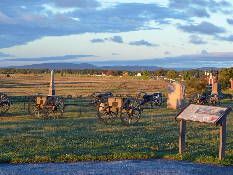 Monuments and Civil War cannons on the free driving tour at Gettysburg National Battlefield in Gettysburg