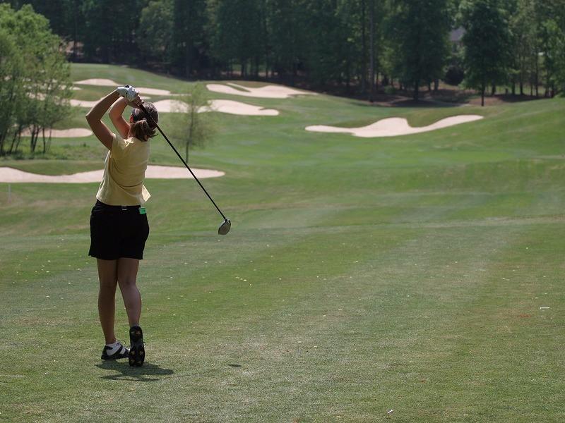 Practicing a golf swing in Stockbridge