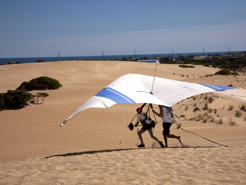Students learning to fly at the largest Hang Gliding School in the country located in the sand dunes of Jockey's Ridge State Park
