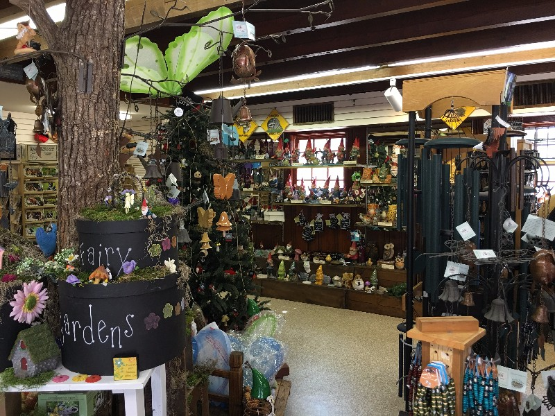 Gift shops with lots of gnome and fairy souvenirs to take home