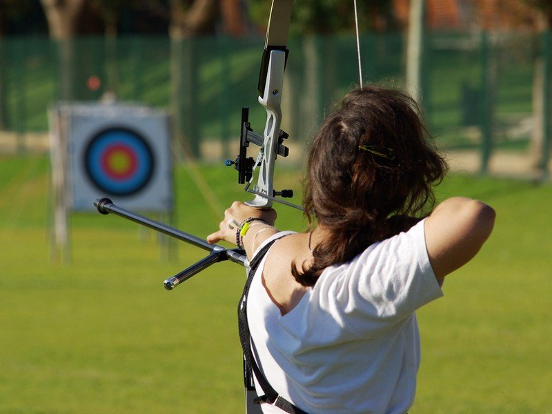 Woman aiming at an archery target