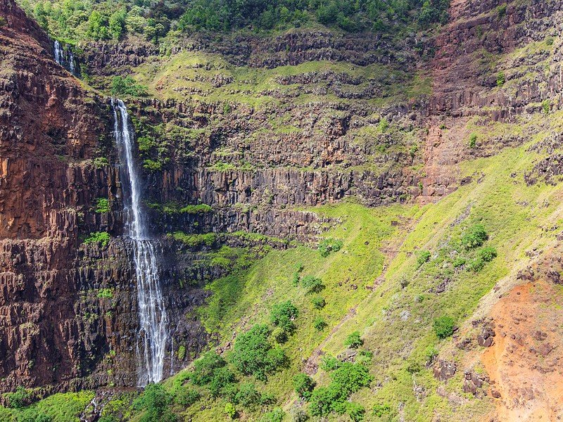 view at remote waterfall at the island of kauai hawaii from helicopter