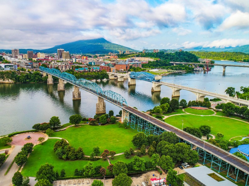 Aerial of Downtown Chattanooga TN Skyline, Coolidge Park and Market Street Bridge.