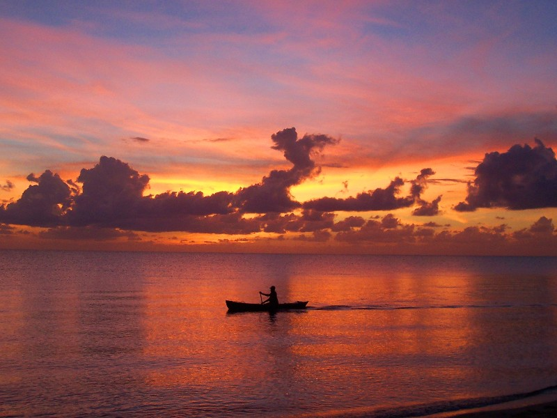 Fishing at dawn in a canoe, Belize