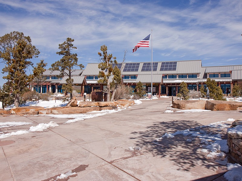 Tourists enter the south rim visitor center at Grand Canyon National Park