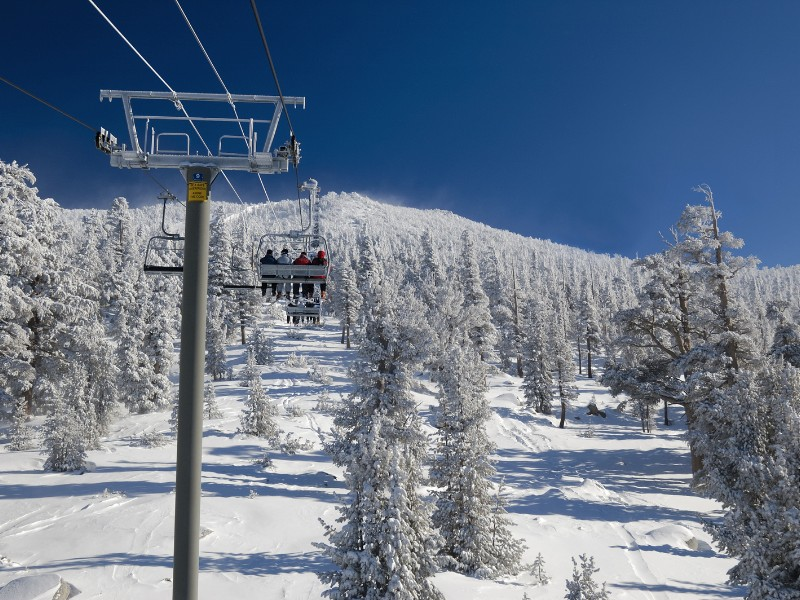 Skiers are riding lift on a very cold day at one of the Lake Tahoe ski resorts