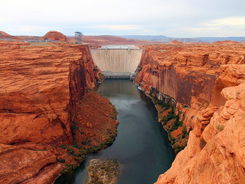 View of red rocks and Glen Canyon Dam