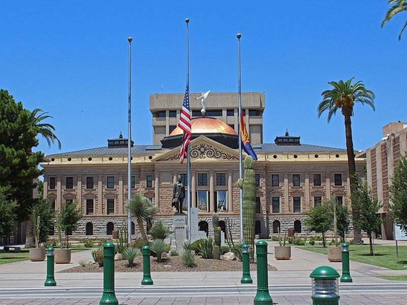 Front of Arizona State Capitol Museum and surrounding grounds against clear blue sky