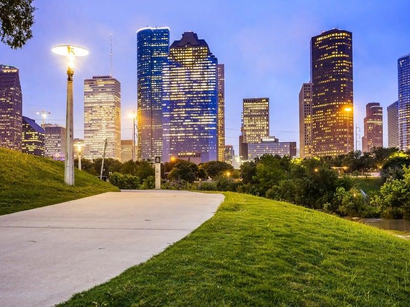 Houston city skyline as night falls and Eleanor Tinsley Park