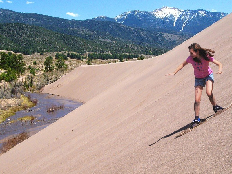 sandboarding at Great Sand Dunes National Park and Preserve
