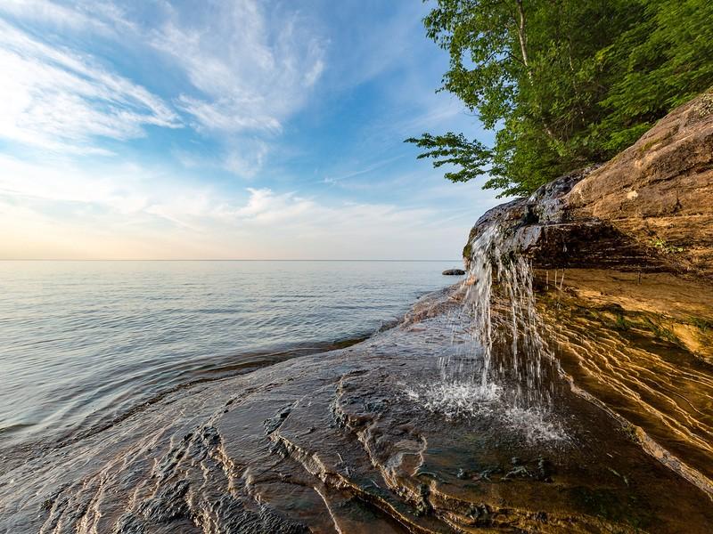 Elliot Falls spills over sculpted rock at Pictured Rocks National Lakeshore in Munising