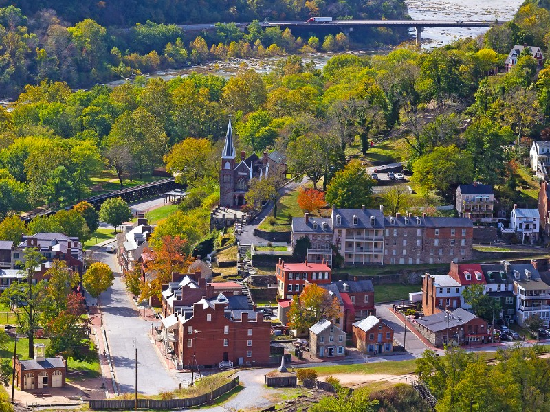 In Harper's Ferry, you can explore the beauty of the Potomac River and visit the quaint downtown area.