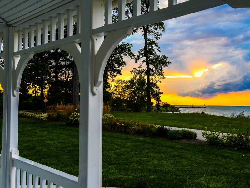 sun setting over the St Lawrence River in Trois-Rivieres, Quebec from a gazebo.