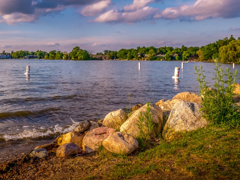 Early evening in the summer on the shore at Goguac Lake in Battle Creek, Michigan