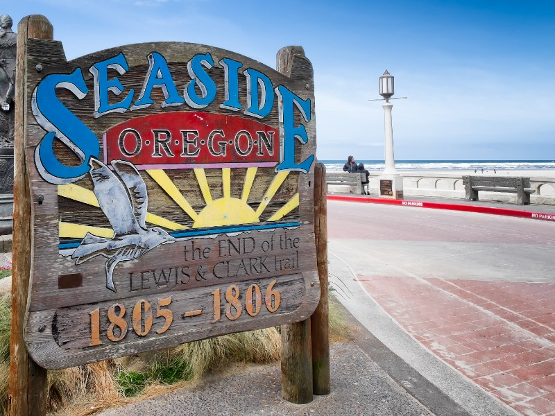 Seaside, Oregon sign commemorating its historic connection to the famous explorers Lewis and Clark, who ended their journey at this spot