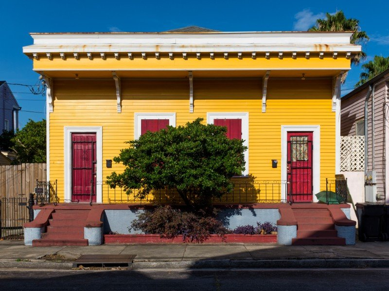 The facade of a traditional colorful house in the Marigny neighborhood in the city of New Orleans