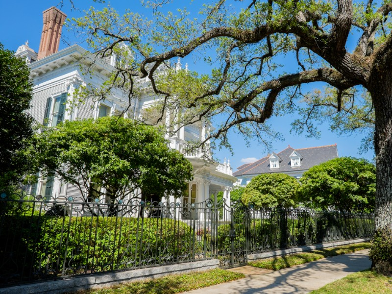 Historical southern style homes along Saint Charles Avenue in New Orleans