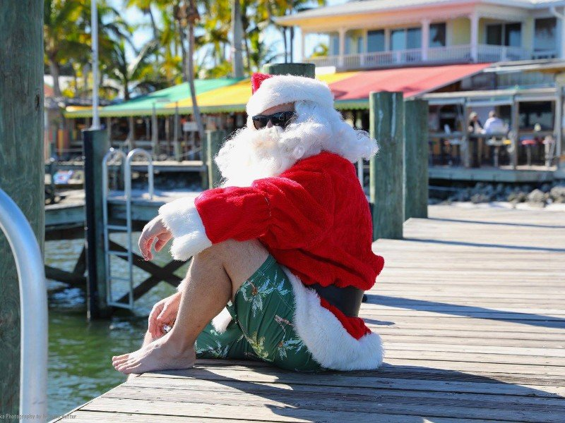 Surfin' Santa poses for photos at Capt. Hiram's Resort.