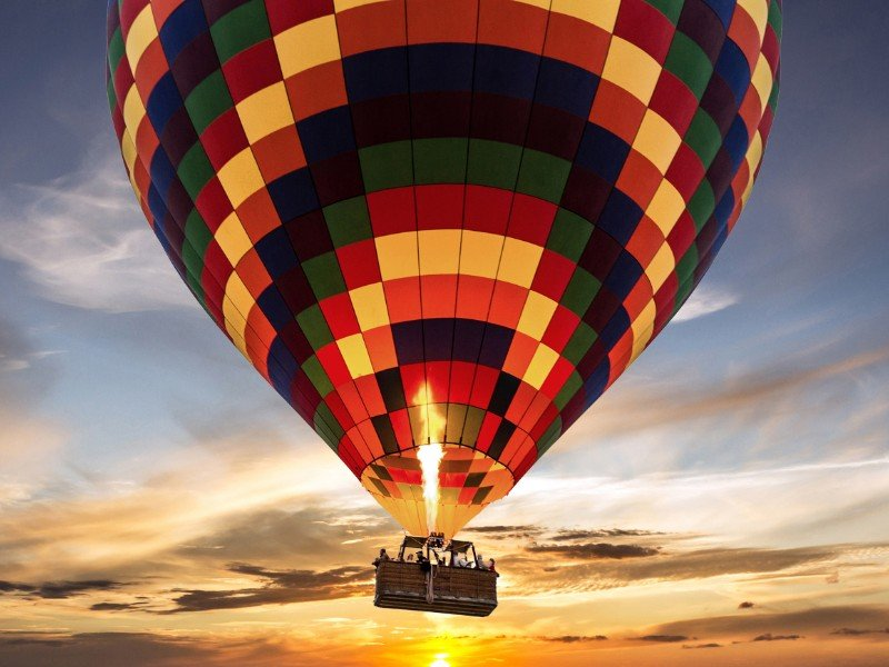 Hot air balloon flight at sunset