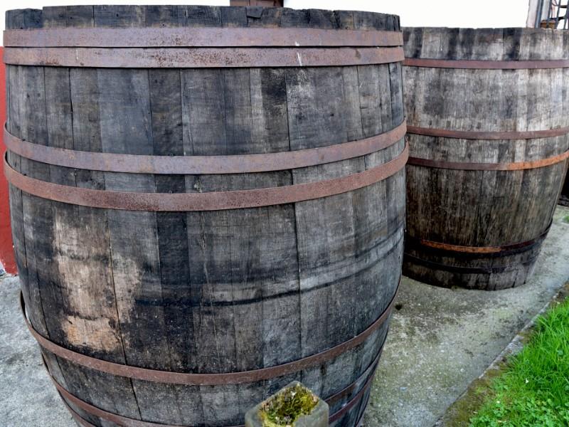 Old barrels of cider in the street, Asturias, Spain