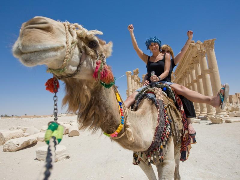 Women on a camel ride