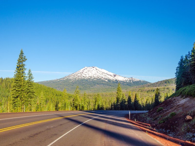 Curving highway with a dramatic view of Mt. Bachelor