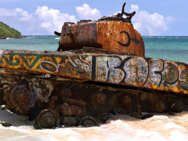 The old rusted and deserted US army tank of Flamenco beach