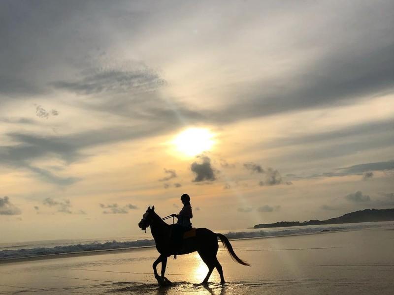 Horseback riding at sunset, Nihi Sumba, Sumba Island