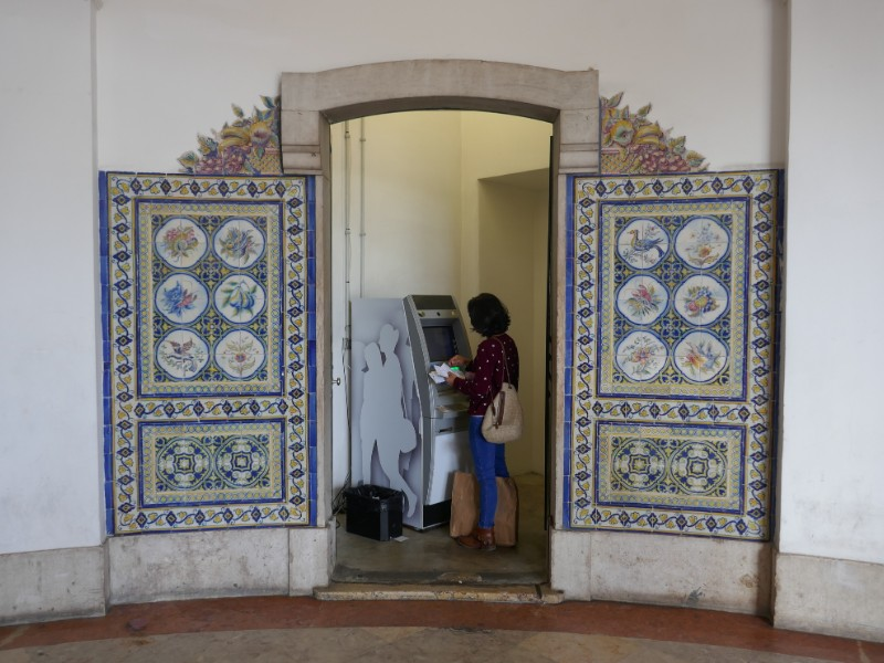 Withdrawing money at the ATM in Lisbon, Portugal