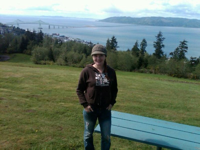K.C. at the Astoria Column, with views of the Astoria and the Columbia River