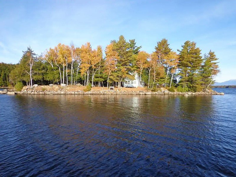 Private island with rustic cabin on large lake