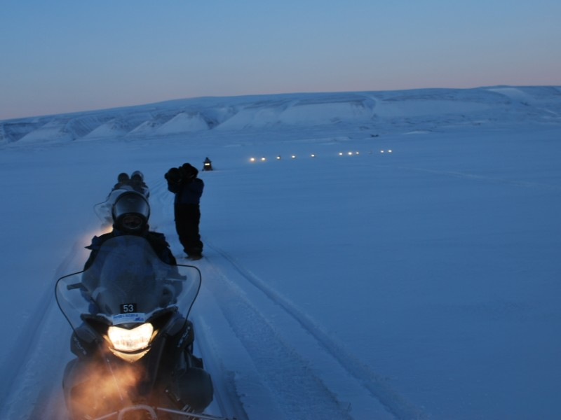 Snowmobiling near Longyearbyen, Norway