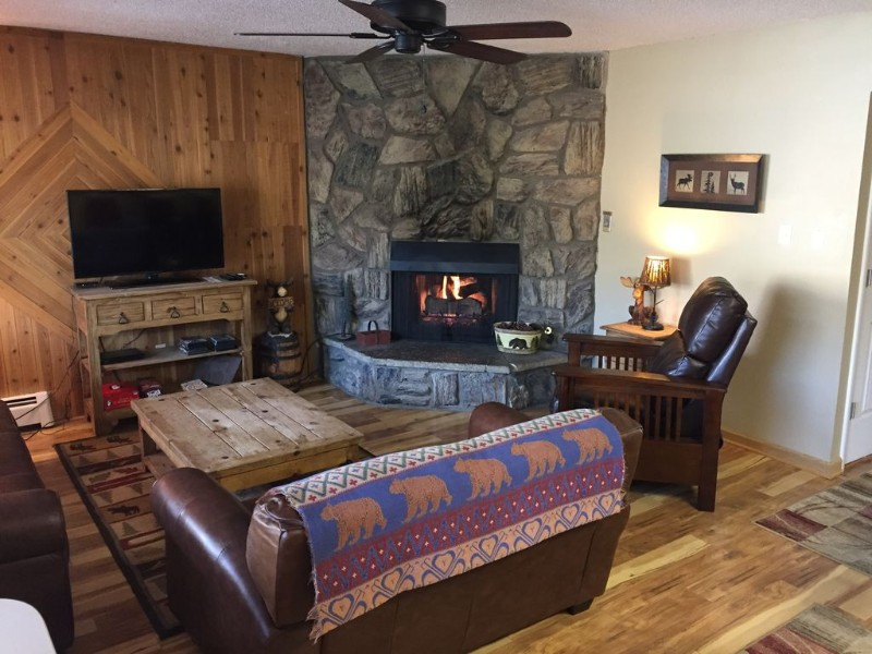 Living room with fireplace at Top Story Condo with Incredible Views, Breckenridge