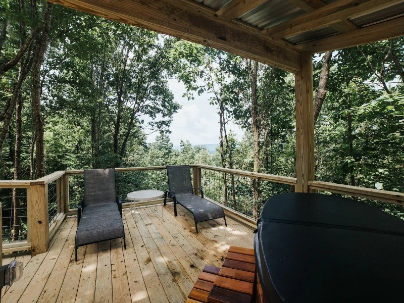Porch at Romantic Tree House Retreat with 15 Private Acres