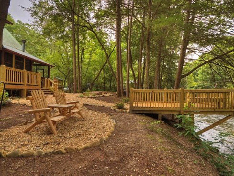 Waterfront creekside cabin features screened porch, private hot tub, & WiFi