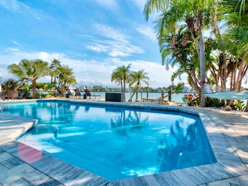 Spot Dolphins From the Pool at This Waterfront Home