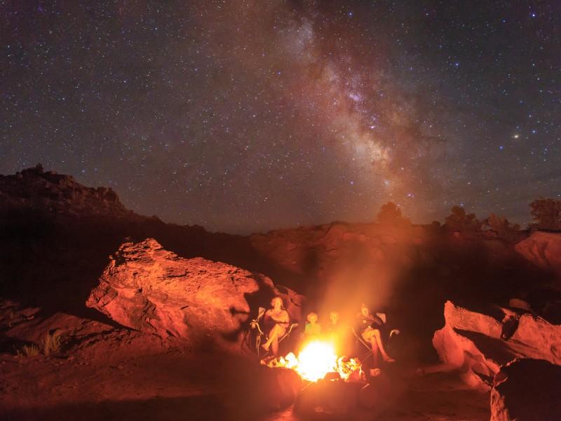 Family campfire at night
