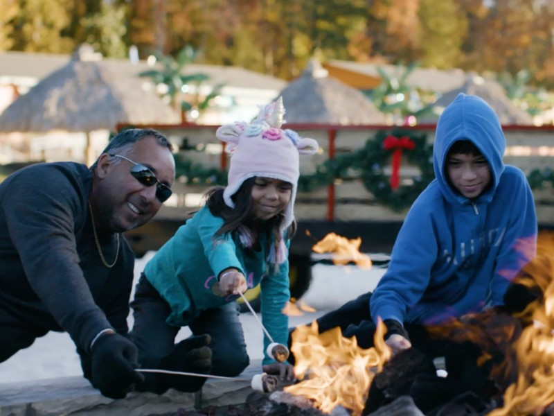 Roasting s'mores around the fire