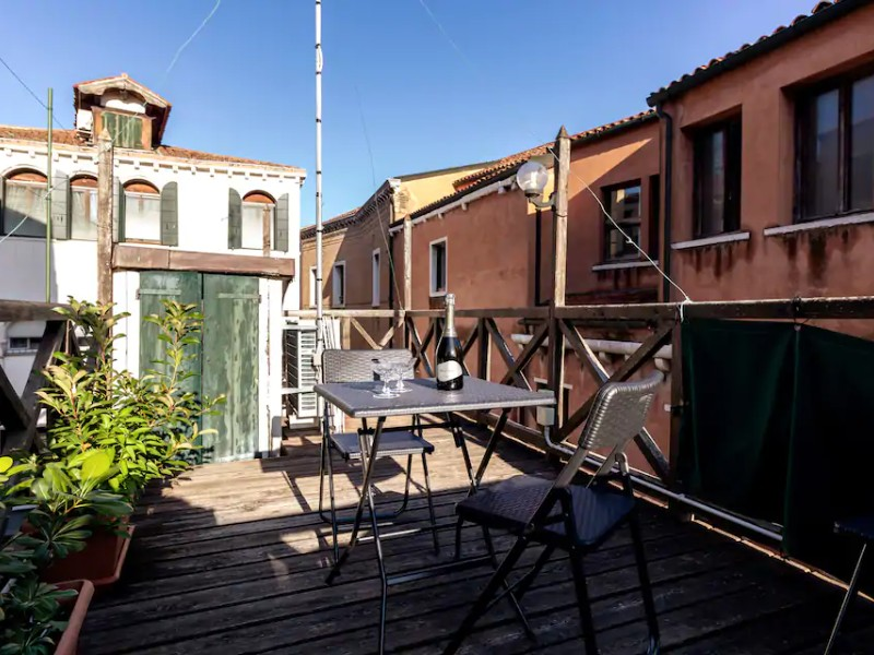 Outdoor seating at Three-Bedroom Townhouse with Rooftop Terrace