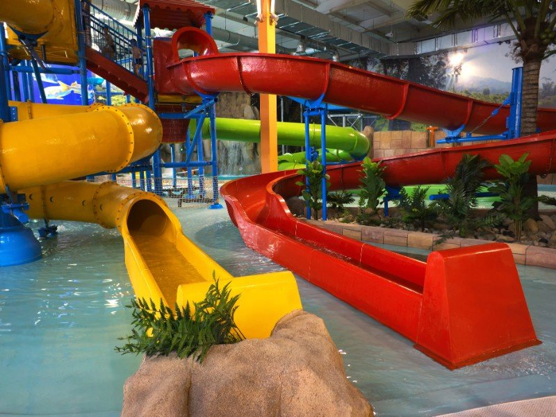 Indoor aqua park with yellow and red pipes