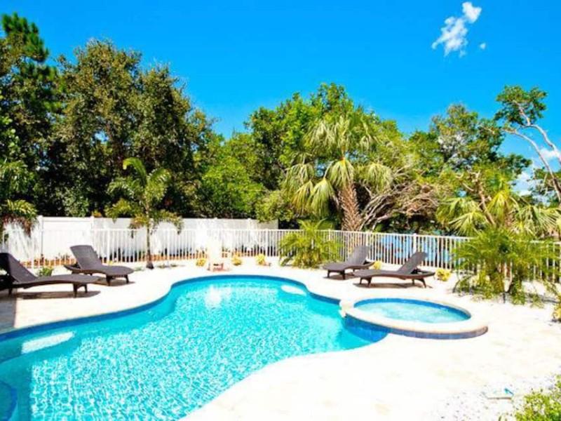 Pool area - Canalfront home w/ heated pool, dock & lanai