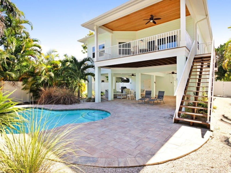 Pool at elevated beach cottage with heated private pool