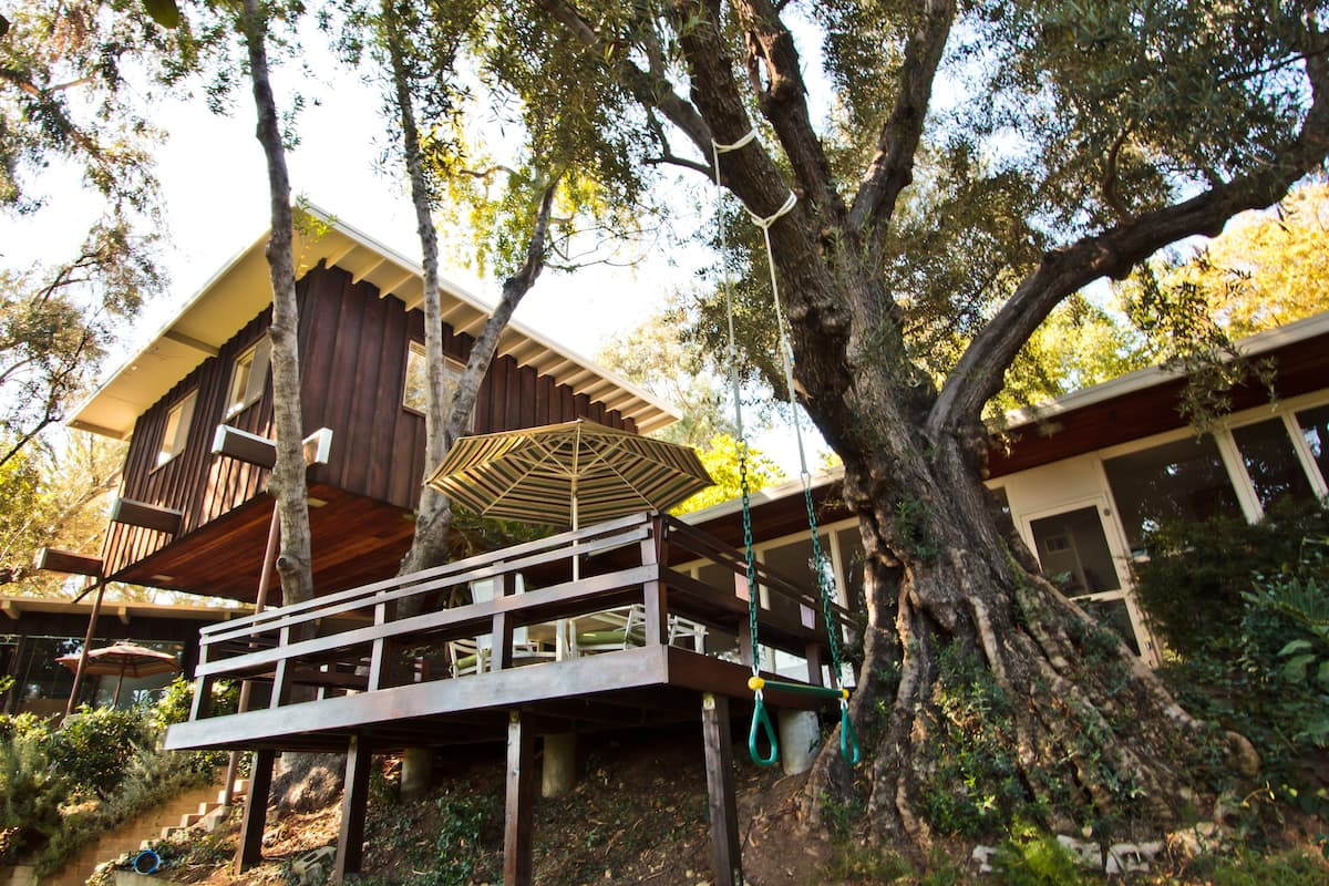 Outside the Private Treehouse in a Mid-Century Home